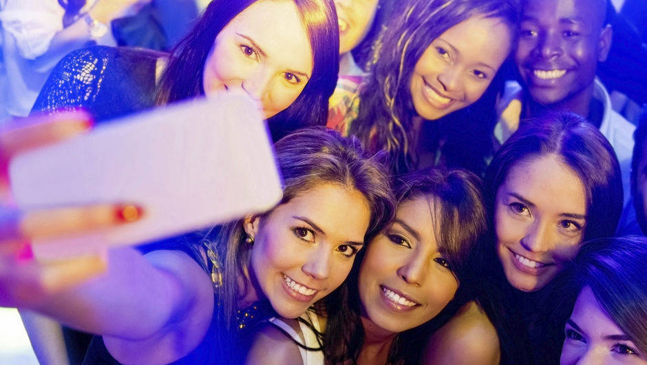 Friends at SMS Party taking a selfie to put on the screens